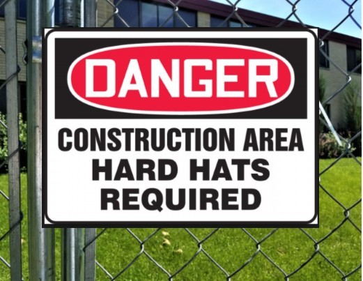 "Sign Says: ""Danger Hard Hat Required"""