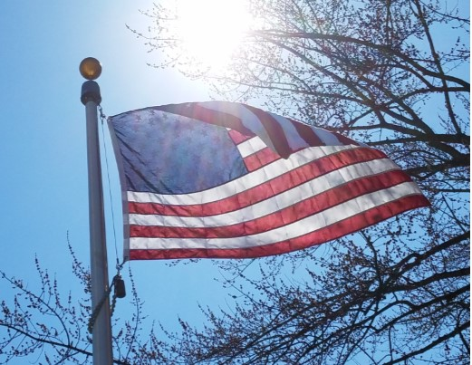 US Flag waving in the Sun